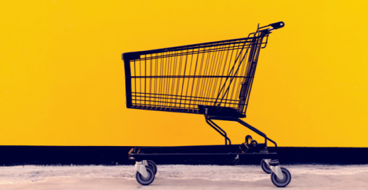 Black shopping cart on yellow background. Very striking.