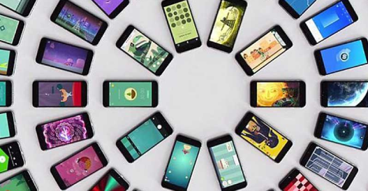 Dozens of smartphones in centric circles with colorful display.